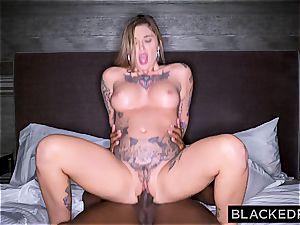 tattooed up superslut Kleio heads black