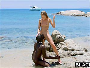 BLACKED intense dark-hued boy bangs blondie tourist on the beach