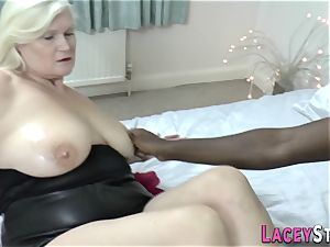 Lacey Starr Gives a Footjob to a black stud