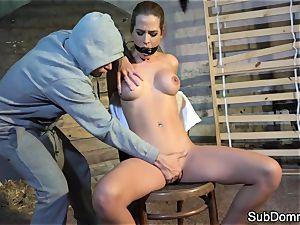 ball-gagged stunner climaxes during restrain bondage