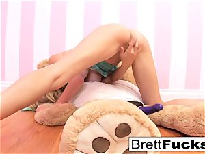 Brett Rossi plays with a strap-on dildo